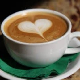 Photo of coffee cup with latte art of a heart